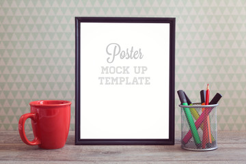 Poster mock up template with coffee cup on wooden table