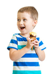 happy kid boy eating ice-cream in studio isolated