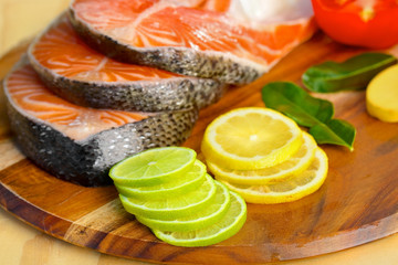 Delicious  portion of fresh salmon fillet with lemons