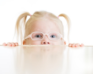 Frightened kid or child in eyeglasses playing isolated