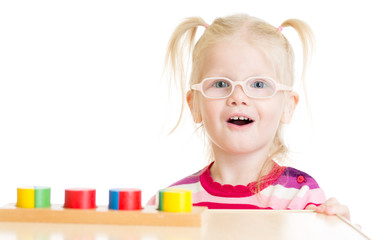 Funny child in eyeglases playing logical game isolated