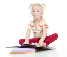 Funny child in eyeglases reading book isolated
