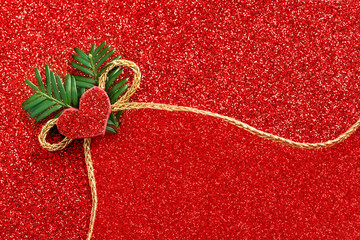 gold gift ribbon bow on red shiny background