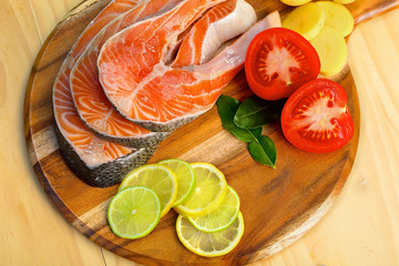 Delicious  portion of fresh salmon fillet with vegetables and