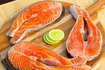 Fresh salmon fillet with lemon - healthy food concept