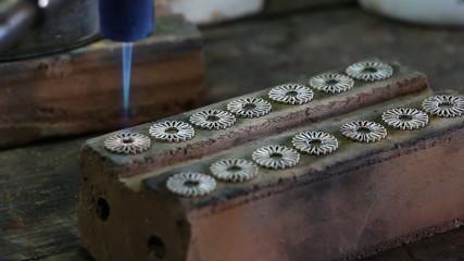 Close up of Jeweler crafting
