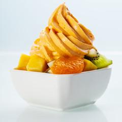 Gourmet Frozen Yellow Yogurt on Fresh Fruits