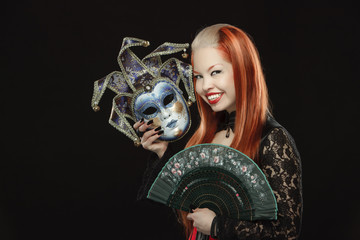 Gothic girl with fan and a mask