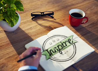 "Businessman Writing the Word ""Inspire"" Concepts"