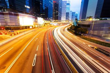 blur motion traffic lights of modern urban city at night