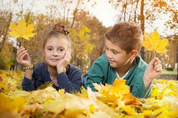 Child lying on the golden leaf