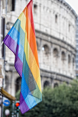Rainbow Flag on rome coliseum background