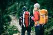 Couple hikers walking vintage retro mountains