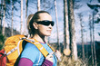Woman hiking vintage winter autumn forest