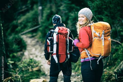 Leinwanddruck Bild Couple hikers walking vintage retro mountains