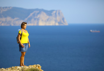 woman traveling on mountain coast
