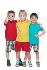 Three fashion little boys stand together