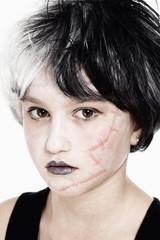 Young Girl in Wig Posing as Frankenstein