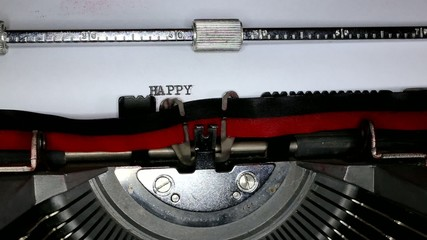 TYPEWRITER with happy in the paper