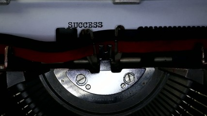 TYPEWRITER with SUCCESS in the paper
