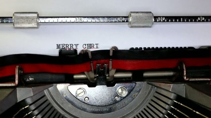 TYPEWRITER with merry Christmas in the paper