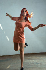 Young woman dancing in the old hall