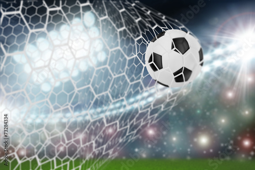 soccer ball in goal net - 73284334
