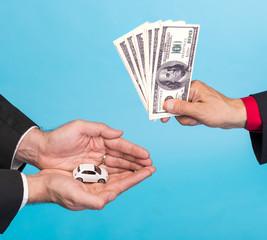 Man holding small car,another man holding dollar bills