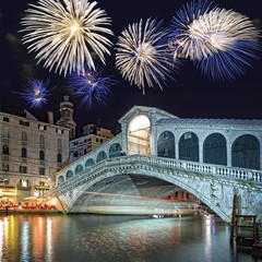Venice Italy, fireworks over the Rialto bridge by night