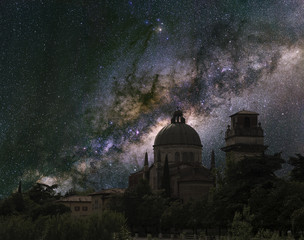 Heaven and Earth. The Milky Way over an Italian church.