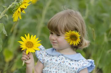 Little girl in a sunflower field