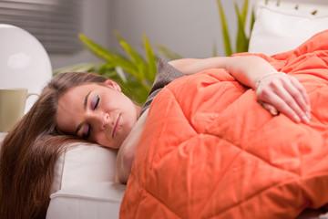 woman softly sleeping on her sofa