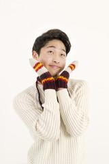 Asian man with fur glove
