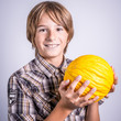 child with yellow melon