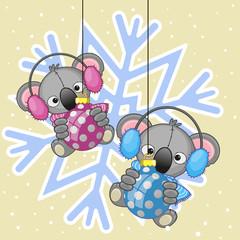 Two Koalas in a fur headphones