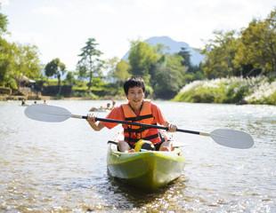 Front view of man kayaking