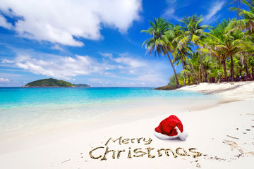 Merry Christmas with santa hat from the tropical beach