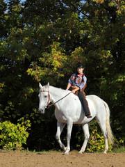 Western girl rides bareback
