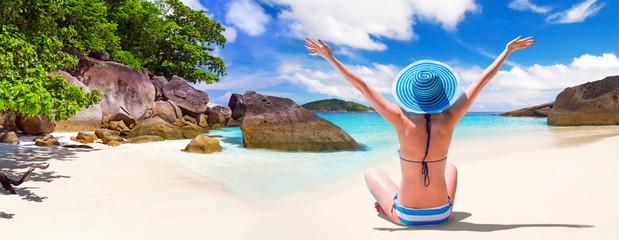 Happy woman enjoying sun holidays on the tropical beach