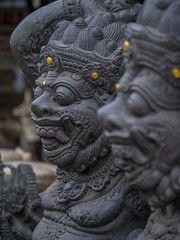 Stone sculpture on entrance door of the Temple in Bali