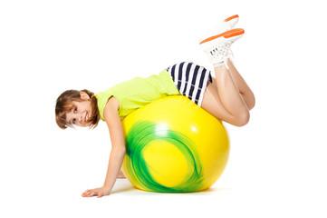 young girl doing gymnastics with ball