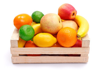 Artificial plastic fruits in wooden crate
