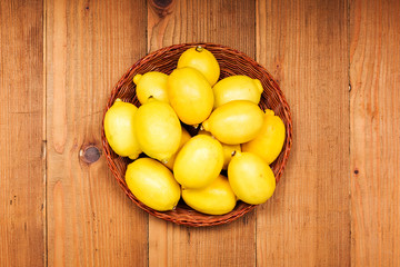 Fresh lemons in wooden tray