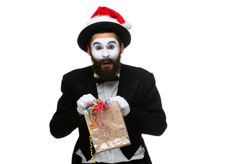 Man with christmas hat and a gift in their hands