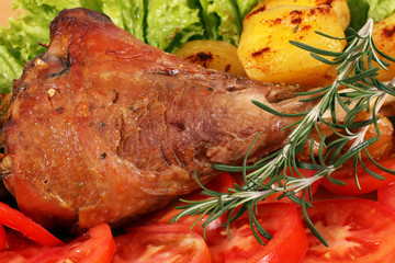 turkey drumstick with vegetables closeup