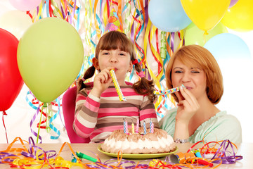 happy mother and daughter on birthday party