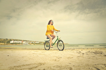 A cyclist at the beach