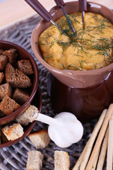Fondue, bowl of rusks, biscuits, spice and garlic