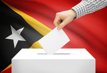 Ballot box with national flag on background - East Timor