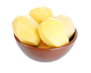 Raw peeled potatoes in bowl isolated on white